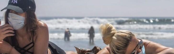 Коронавірус у світі: в Іспанії маски зобов'язали носити навіть на пляжі